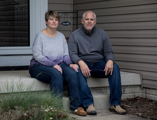 Dave and Jodi Doney sit on their front porch. Jodi is now recovered from COVID-19. While sick, she and her husband, who never contracted the illness, remained in seperate parts of their Pataskala home.