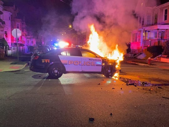 The patrol car that caught fire in a law enforcement pursuit of a weapons and drug suspect on Saturday night.