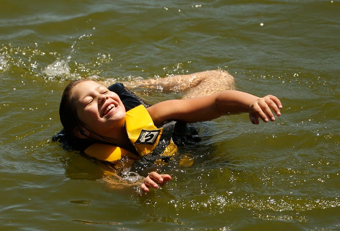 Sophie Alvarez spins in the water as her family visits Bartlett Lake northeast of Carefree to avoid the triple-digit heat on April 26, 2020.