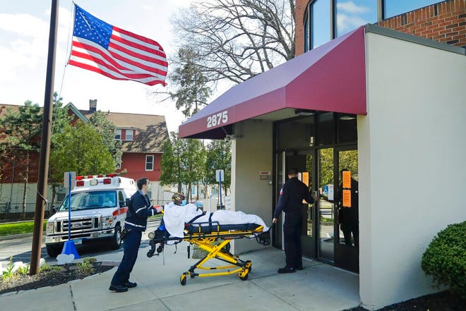 Medical workers bring a patient to the Northbridge Health Care Center Wednesday, April 22, 2020, in Bridgeport, Conn. To slow the spread of the coronavirus inside nursing homes, Connecticut has begun transferring infected residents to off-site recovery centers following their release from hospitals. The plan has sparked some fears about the effects for frail, elderly residents who might be displaced to make room in repurposed care facilities. But public health experts see potential in the effort to find a way to curb the outbreak that has ravaged elder care facilities globally.  (AP Photo/Frank Franklin II)