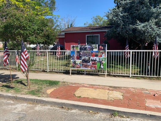 Photos of fallen Marine Corps Gunnery Sgt. Diego Pongo, of Simi Valley, were set out in front of his family's home Sunday for a surprise drive-by parade amid coronavirus restrictions. Pongo was killed in Iraq in March during a mission against an Islamic State group stronghold, according to military officials.