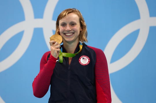 Katie Ledecky celebrates after winning the gold medal in the 800-meter freestyle at the 2016 Rio Olympics.