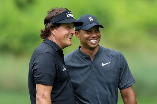 Phil Mickelson, left, and Tiger Woods, seen in August 2018, will face off once again Sunday in The Match: Champions for Charity at the Medalist in Hobe Sound.