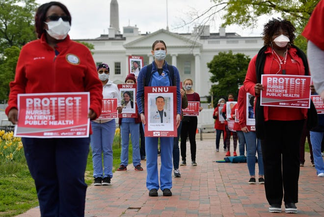 Medical workers protest in front of the White House on April 21, 2020.
