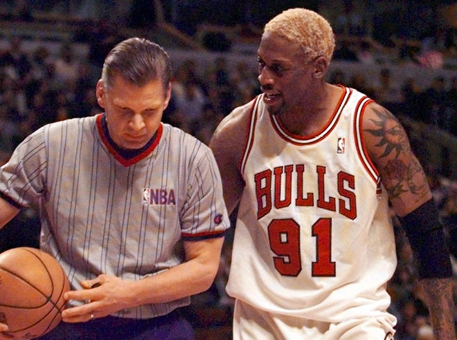 Dennis Rodman shares his thoughts with an official during a March 1998 game.
