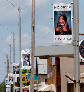 Pictures of the Crescent High School graduating class of 2020 are seen in downtown Crescent, Okla., Saturday, April 25, 2020. The pictures were hung to recognize the senior class that doesn't know what their graduation ceremony will look like.
