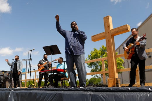 Worship Arts pastor Lance Brooks leads the worship band during an outdoor church service at Cornerstone Church in Athens, Ga, on Sunday, April 26, 2020.