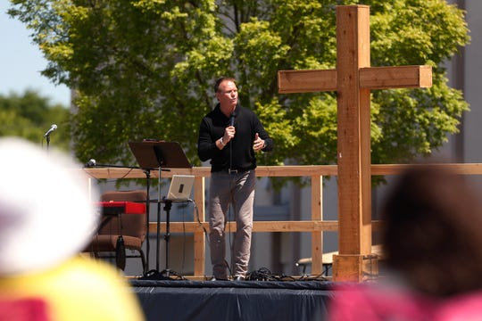 Lead pastor Scott Sheppard preaches at an outdoor church service at Cornerstone Church in Athens, Ga., on  April 26, 2020.