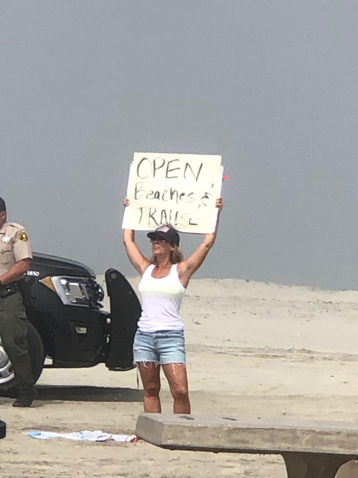 Police arrest 3 people protesting closed beaches at SoCal beach set to reopen Monday