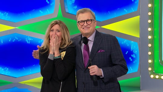 """Debra Field of South Brunswick, N.J., and """"The Price Is Right"""" host Drew Carey."""