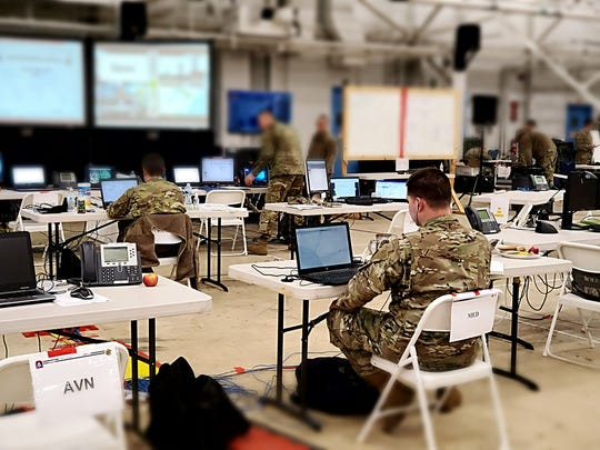 Army soldiers working in the Tactical Operations Center at the Battle Creek Air National Guard Base.  Provided