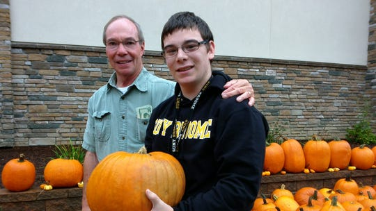 Deacon Dale Crotsley, left, with Robby Brown at Our Lady of Sorrows' pumpkin patch in 2015.