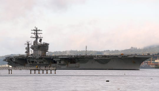 The USS Nimitz passes Waterman Dock as it departs Naval Base Kitsap-Bremerton on Monday, April 27, 2020.