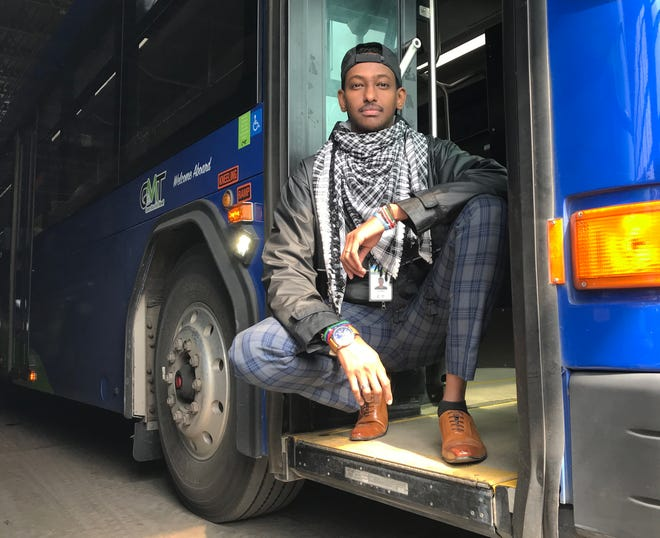 Farhan Ahmed, 28, a bus driver and dispatcher at Green Mountain Transit, pauses after a morning shift at the maintenance depot on Queen City Park Road in Burlington on April 24, 2020.  Ahmed is also a union shop steward for GMT, and has worked to improve health safety during the coronavirus pandemic. His family arrived in the U.S. from Kenya in 2007.