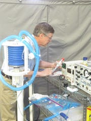 Jim Richards testing the AeroBreath ventilator he developed with two other engineers.