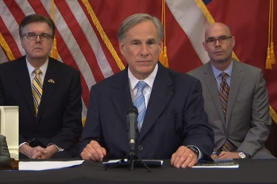 Gov. Greg Abbott, flanked by Lt. Gov. Dan Patrick, left, and House Speaker Dennis Bonnen at the Texas Capitol, April 27, 2020.