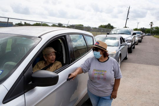 Cars line up near the Greenwood Senior Center, awaiting lunch service on Monday, April 27, 2020. Many seniors over 60 have stayed in their homes since the coronavirus pandemic began to spread across Texas. Senior centers have provided food for them during the week.