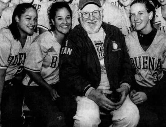 """Charles """"Pop"""" Fellenbaum (center), was the No. 1 fan of the Buena Regional High School softball team. He poses here with players from the 2009 squad."""