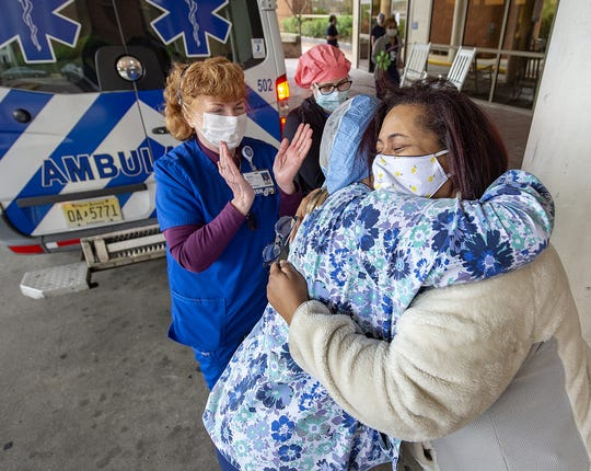 Hugs of gratitude to healthcare workers, from Nia Jackson, (right), of Philadelphia, Pa., the daughter of Kim Dobson, 63, of Burlington City, who was released from Virtua Memorial in Mount Holly, after battling COVID-19, Monday, April 27, 2020, to a rehabilitation center for recover