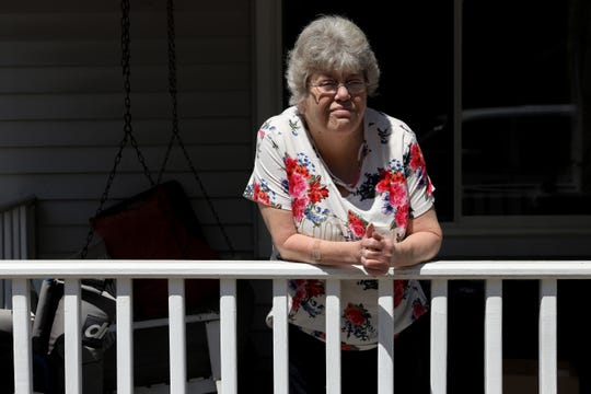 Rebecca Caldwell, of Covington., stands for a portrait on April 27 outside her home. She received medicine from Faith Community Pharmacy. Born with a disability, she's on a fixed income with Social Security Disability Insurance. She suffers from several chronic illnesses, including diabetes and high blood pressure.