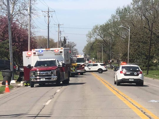Des Moines first responders work a crash scene before noon Monday, April 27, 2020, near Douglas Avenue and Beaver Avenue. A man working on a construction site has died after being hit by a car, police say.