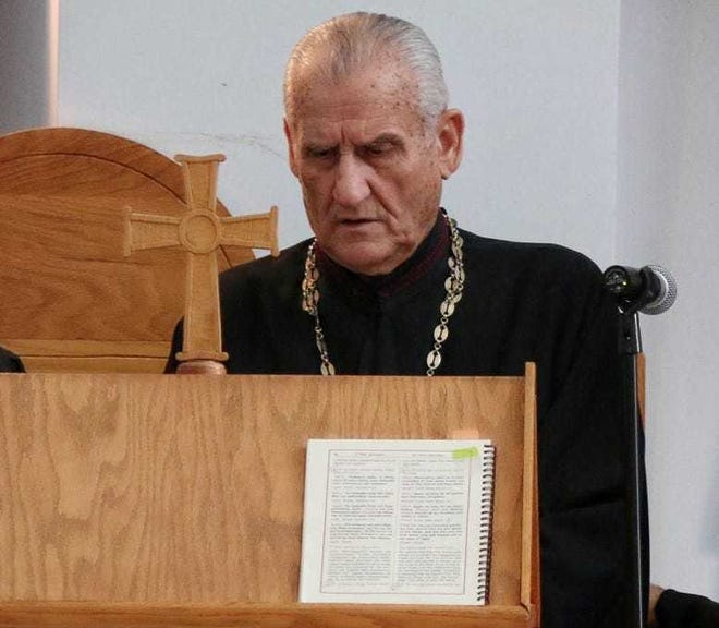John Angelopoulos chanting during Mass.