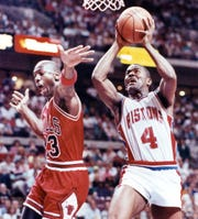 Pistons guard Joe Dumars makes a layup as Bulls guard Michael Jordan reaches in during the first quarter of the Game 7 of the 1990 Eastern Conference finals on June 3, 1990, at the Palace of Auburn Hills.