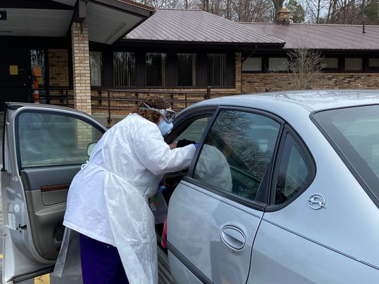 Certified medical assistant Christina Mitchell works the parking lot at Midland Family Physicians so that families can avoid coming into the office. Some pediatric patients receive vaccines in their vehicles.