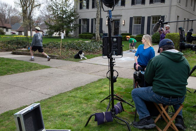 Alan Karcher, 55, of Grosse Pointe Park participates in The Jurisdiction of the Ministry of Silly Walks in front of the the Koto family's home in Grosse Pointe Park just before Liz Koto is interviewed by Inside Edition Monday, April 27, 2020.