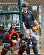 Tigers catchers Jake Rogers, background, and Eric Haase go through drills during spring training.