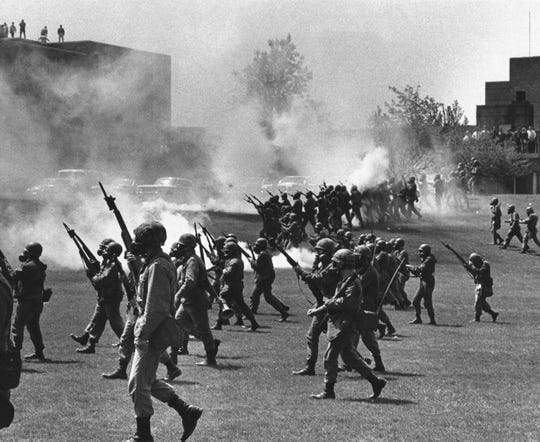 The Ohio National Guard moves in on rioting students on May 4, 1970, at Kent State University in Kent, Ohio.