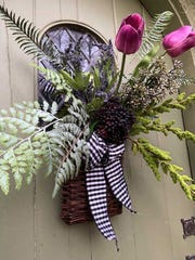 Willow Basketfilled with:Black and White Check Ribbon,Amaranths Stem,Boston Fern,Royal Fern,Lavender Pick,Burgundy Seed Bunch,Purple Long Seed Stem,Large Plum Tulips.