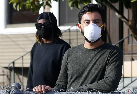 Oko Carter, 30, left, and Andres Vidaurre share a home Los Angeles with eight other people. (Luis Sinco/Los Angeles Times/TNS)