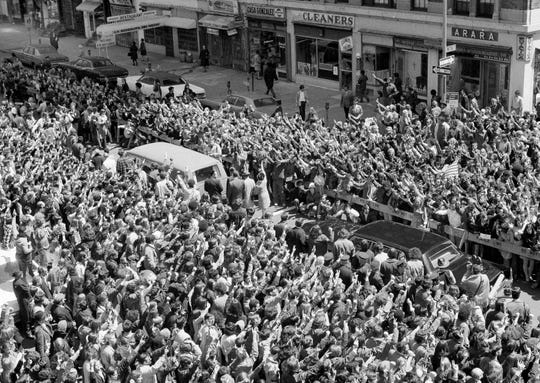 Thousands of people crowd around the cortege bearing the body of Jeffrey Glenn Miller after funeral services in New York, May 7, 1970. Miller, a 20-year-old student, was one of four people killed during disturbances on the Kent State University campus in Ohio on May 4.