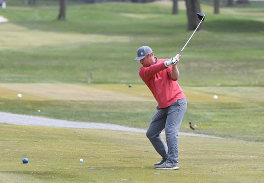 A player tees off on Friday at Red Run in Royal Oak after the restrictions on golf were lifted.