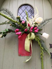 Rustic Red Tinis filled with:Green Linen Ribbon,Amaranths Stem,Real Touch Boston Fern,White Peony Bud Bunch,Pink Peony Bud Bunch,White Astilbe Stem,Fuchsia Tulip Bunch,Large White Tulips(can substitute tulips for White Peony Stemsas well). (Nell Hill's/TNS)