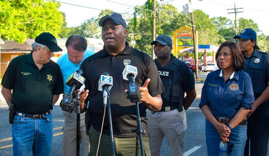 Baton Rouge Police Chief Murphy Paul speaks to reporters in Baton Rouge, La., Sunday, April 26, 2020. A shooting has left one police officer dead and a wounded colleague fighting for life, authorities said, adding a suspect was in custody after an hourslong standoff at a home.