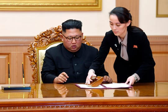 In this Sept. 19, 2018, file photo, Kim Yo Jong, right, sister of North Korean leader Kim Jong Un, helps Kim sign joint statement following the summit with South Korean President Moon Jae-in at the Paekhwawon State Guesthouse in Pyongyang, North Korea.