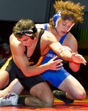 Horseheads' Dan Manganaro wrestles Ithaca's Jory Nickles in 2010.