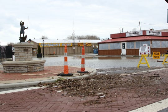Strong wings accompanying another Nor'easter storm pushed water and debris onto the street in downtown Port Clinton.