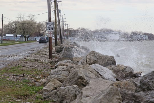 High northeasterly winds pushed water and debris onto Lakeshore Drive.