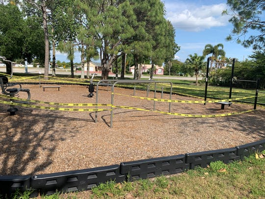 Yellow tape keeps exercise equipment off limits at Lake Kennedy Community Park in Cape Coral. The city council was expected to vote Monday on reopening parks for walking and biking, but playground areas, such as this one, would remain closed.