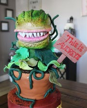"""Bess Charles said her cakes have replicated """"Little Shop of Horrors,"""" a hearse, planes, helicopters and dinosaurs."""