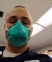 Jeff Johnson takes a selfie at the Bellevue Hospital in Manhattan, where he is helping coronavirus patients.