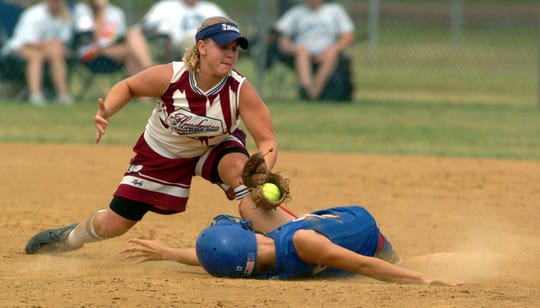 Henderson County shortstop Megan Brown tags out Allen County-Scottsville's Ashley Oakes (17) at second base during the 2005 state tournament in Owensboro.
