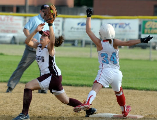 Henderson County first baseman Ashley Crooke snags the throw for the out as UCHS's Kendall Cartwright (34) stretches for the base during the 2010 district championship game in Henderson.