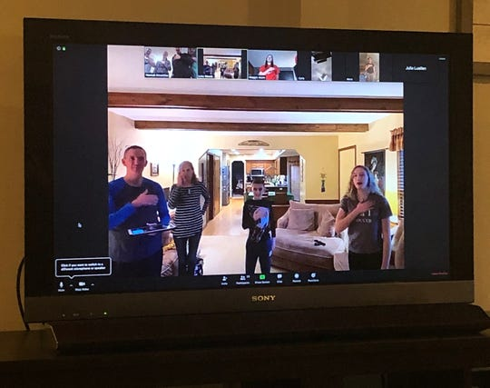 A photo of a virtual meeting of the Extraordinary Explorers 4-H club, with advisors Luke and Patty Woods and their children CeCe and Dominic on the main screen. Clubs across the county are holding remote meetings during the ongoing coronavirus pandemic.