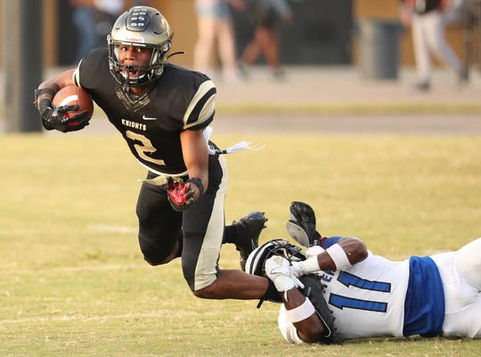 Ocoee High's Dexter Rentz Jr. (2) runs during the Apopka High at Ocoee High School football game on Friday, September 13, 2019. (Stephen M. Dowell/Orlando Sentinel)