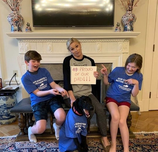 Kentucky first lady Britainy Beshear and children Will, left, and Lila, right, and dog Winnie, showed support for Gov. Andy Beshear.