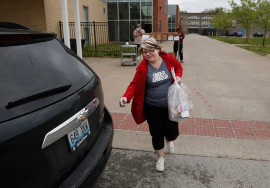 Melissa Houston hands out food to JCPS families at the Valley High School location on April 24, 2020.